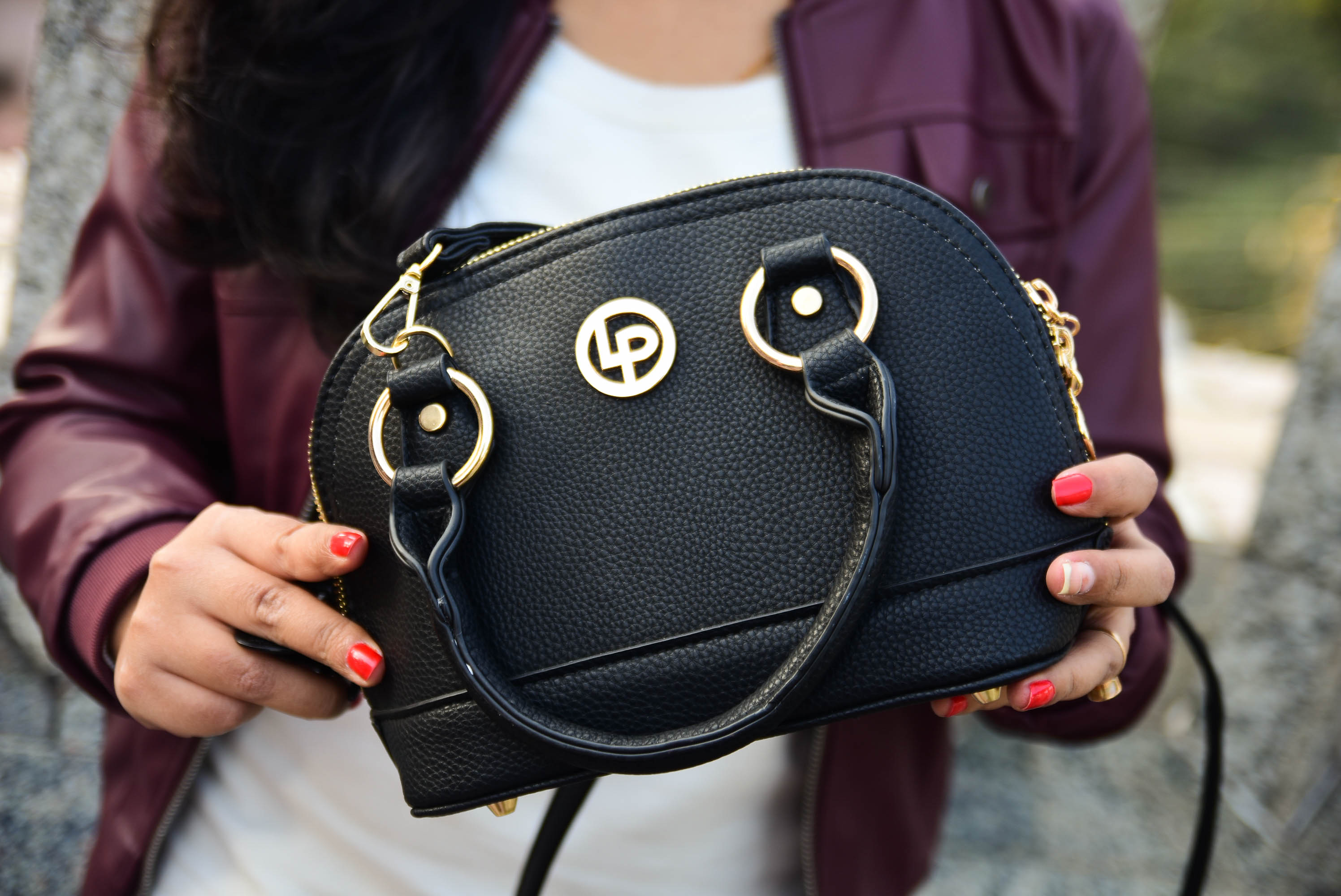 The Little Black Bag Ft. Lino Perros- Lino Perros Black Sling Bag
